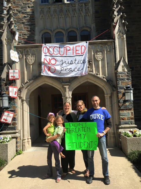 Duke Faculty Union members pose with protesting students in front of the Allen Building.